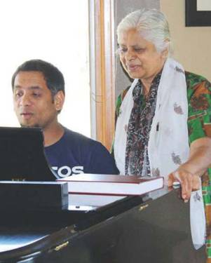 Santosh Poonen playing piano